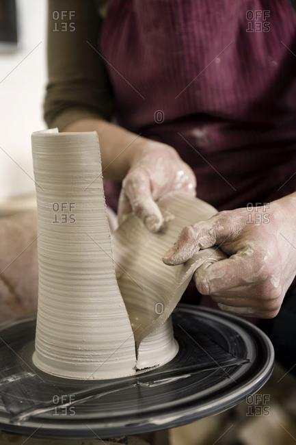 Craftswoman working on pottery wheel, Bavaria, Germany, Europe