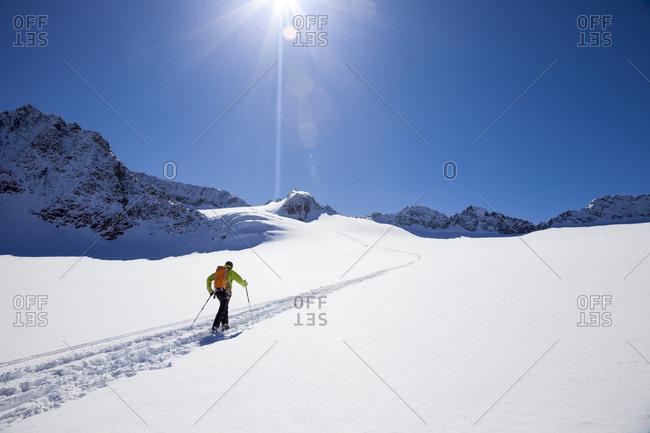 Skier walking across glacier, Stubai, Tyrol, Austria