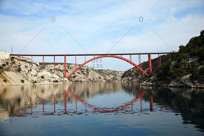 Croatia, Red Bridge reflected in the sea