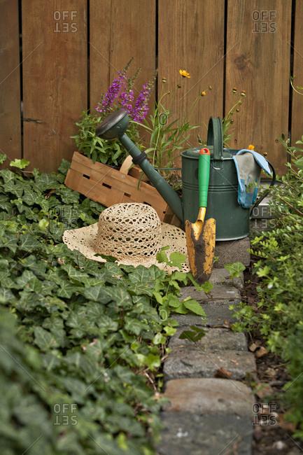 Garden equipment, flowers and straw hat in the garden, Munich, Bavaria, Germany