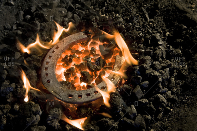 Horseshoe lying on burning coal, Landshut, Bavaria, Germany