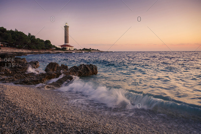 Waves crashing on the beach at sunset, Dugi Otok, Dalmatia, Croatia