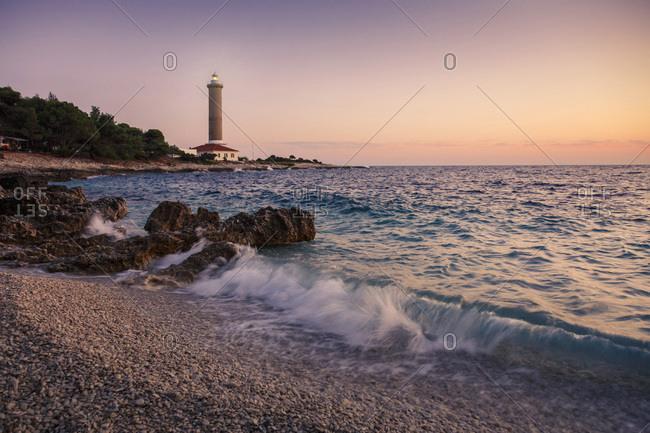 Waves crashing on the beach at sunset, Dugi Otok, Dalmatia, Croatia