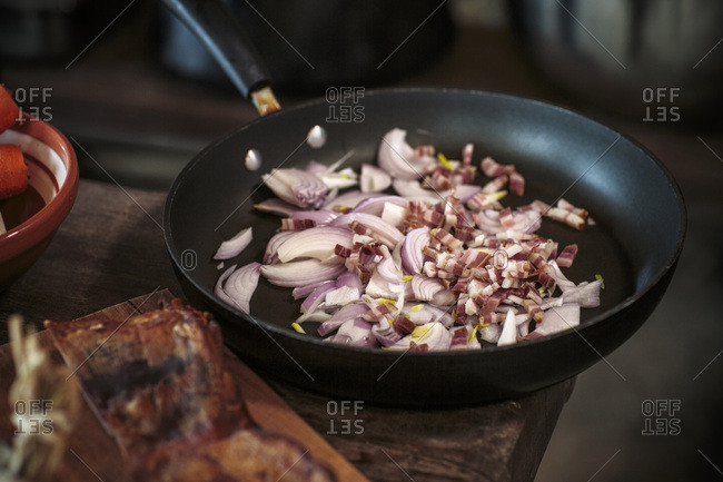 Onions and bacon in frying pan