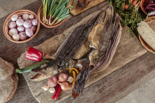 Pike fish among variety of ingredients and vegetables