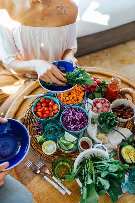 Woman making macro bowl