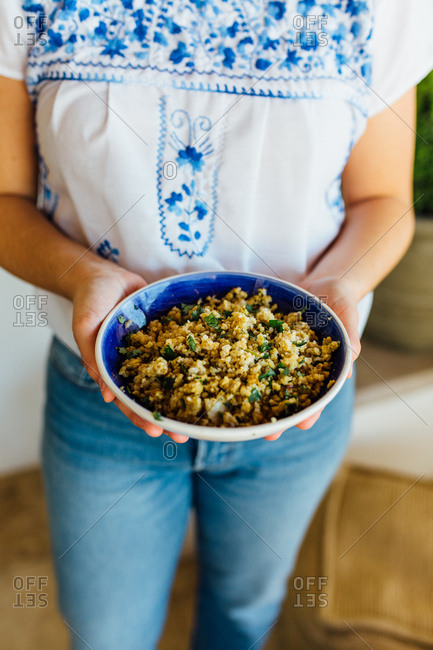 Woman holding bowl of quinoa