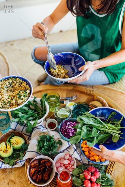 Women serving quinoa