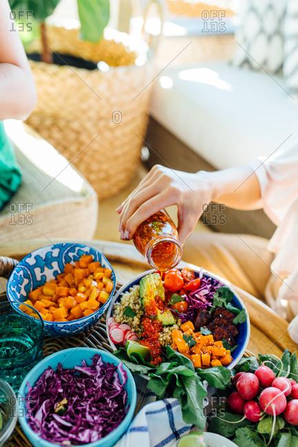 Woman preparing macro bowl