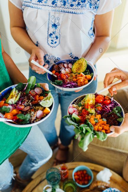 Women holding macro bowls