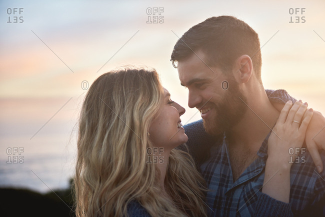 Couple hugging looking at each other lovingly
