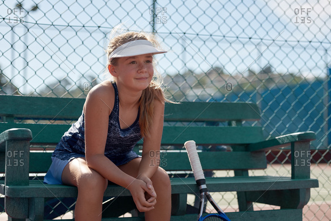Portrait of young sportswoman mentally preparing for her tennis training match