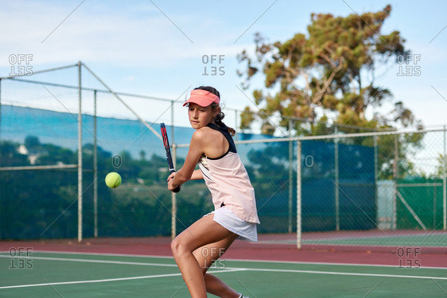 Close up portrait of young female tennis player concentrating and focusing on her forehand game