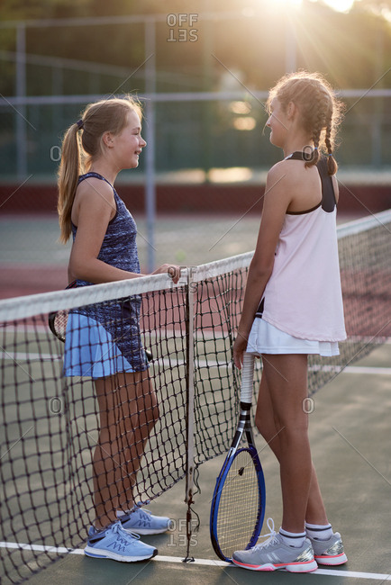 Competitors opponents discussing after their tennis match game