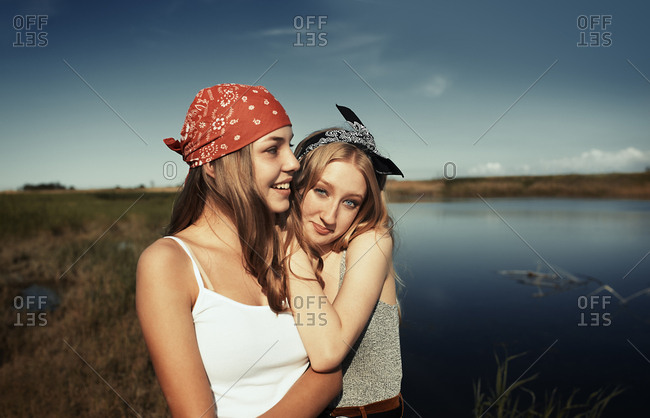 Two young teen girls having fun at the lake