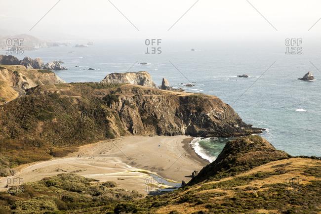 Sandy beach below rocky cliffs on the Northern California Coast
