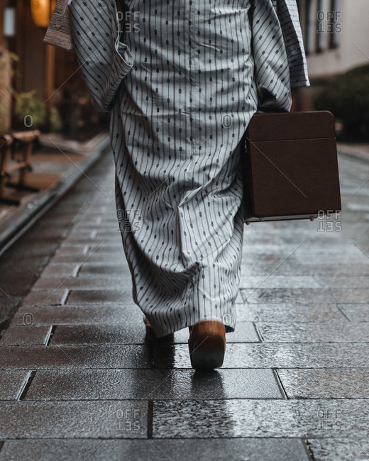Person wearing traditional Japanese clothing walking on street