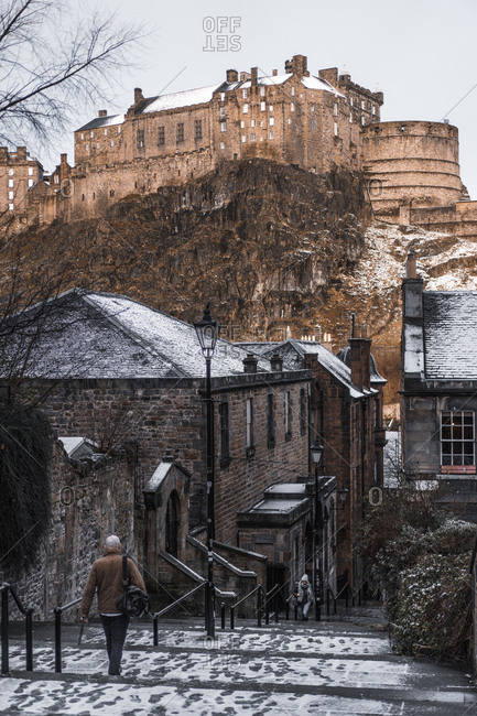 Edinburgh, Scotland - January 16, 2018: People walking on stairs through town on winter day