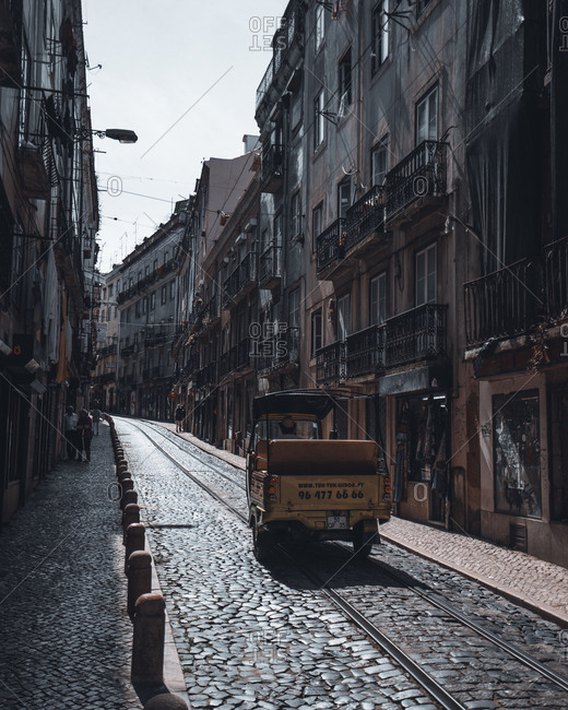 Lisbon, Portugal - May 16, 2017: Small truck on railway in street
