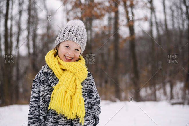 Portrait of young girl outside in the snow
