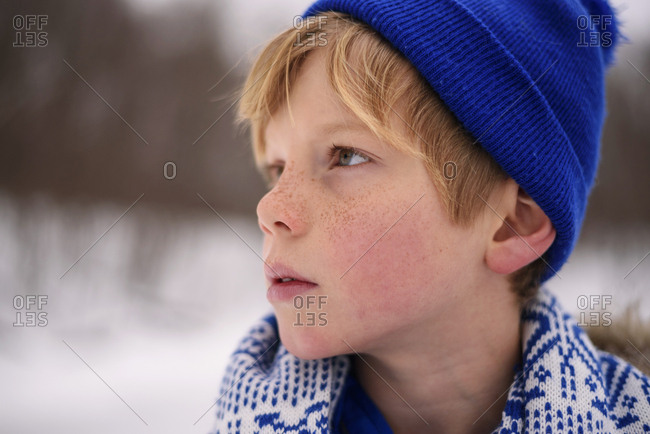 Portrait of young boy outside in the winter