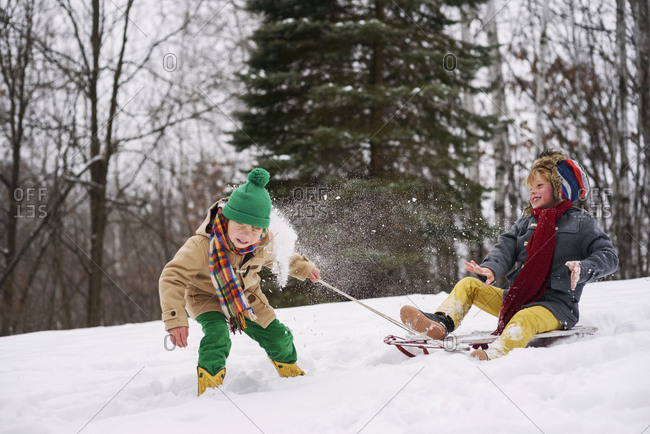 Two young boys throwing snowballs