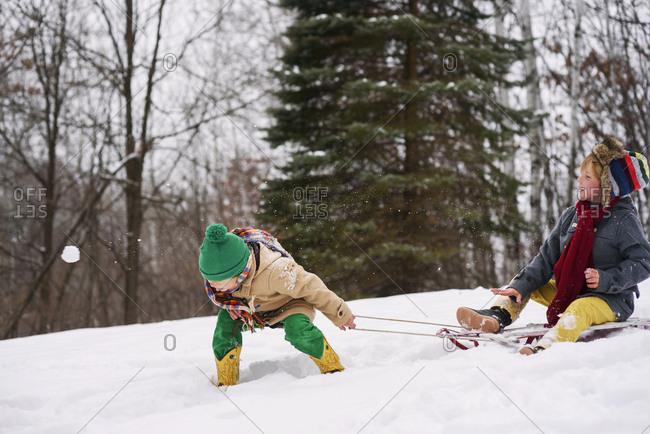 Two boys throwing snowballs
