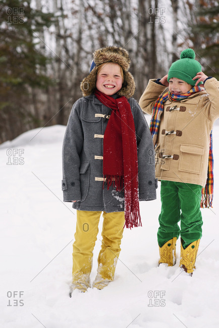 Two young boys playing in the snow