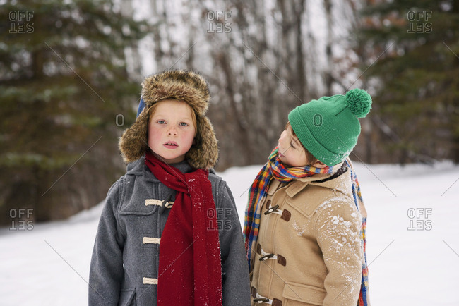 Portrait of two young boys standing in the snow