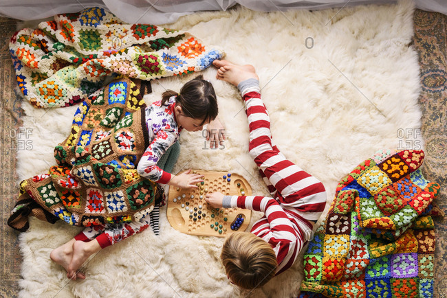 Two children inside playing a board game