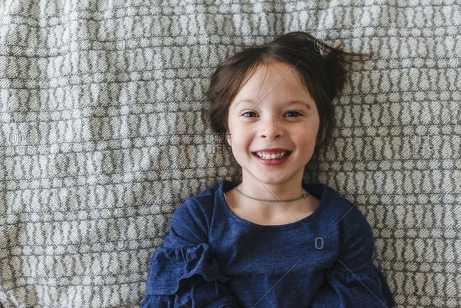 Happy girl lying on bed
