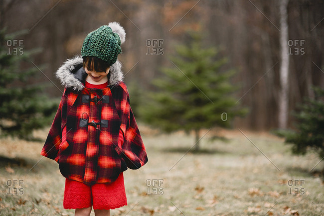 Portrait of young girl outside dressed for the holidays