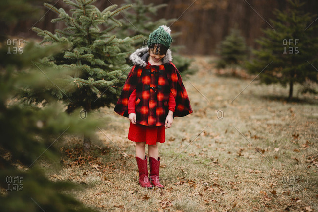 Young girl outside dressed for the holidays