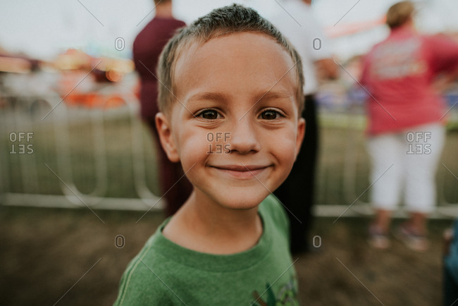 Smiling boy at a festival