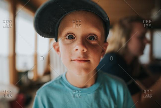 Portrait of a boy wearing a baseball cap