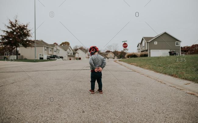 Toddler boy walking on street