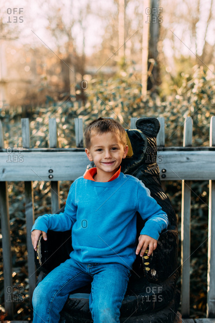 Boy sitting on bear seat at zoo