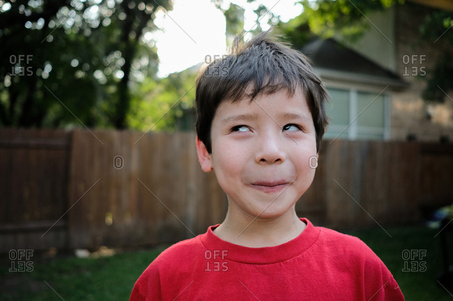 Young boy making silly expression