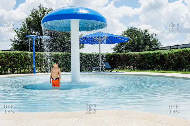 Young boy playing in a swimming pool