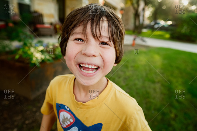 Happy young boy wearing yellow shirt