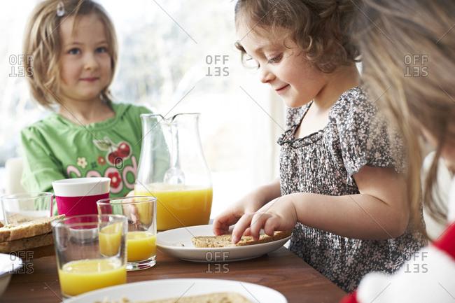 Little children at breakfast table