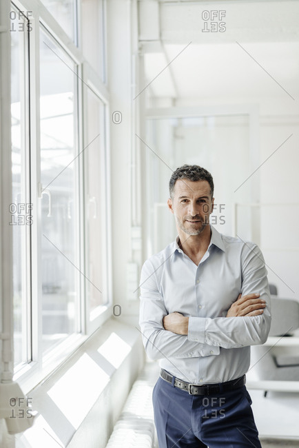 Portrait of confident businessman at the window