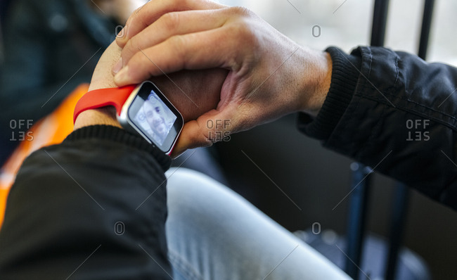Man taking a selfie with his smartwatch