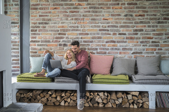 Couple sitting on couch-