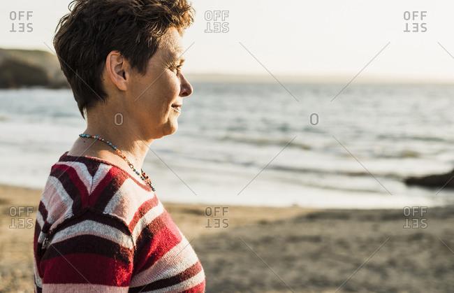France- Crozon peninsula- Portrait of mature woman at beach