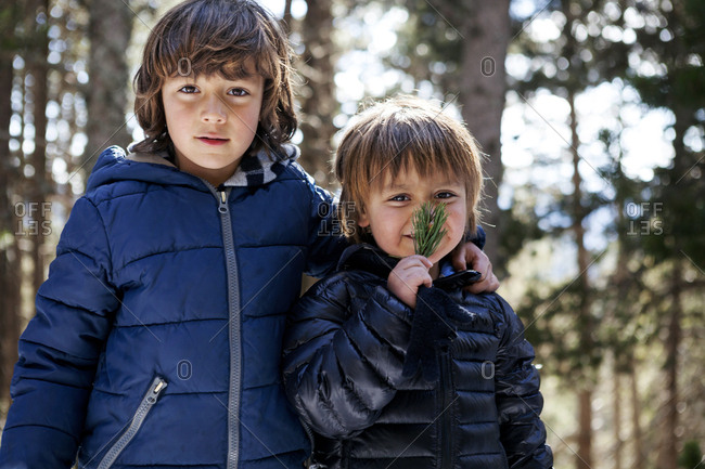 Portrait of two little boys in the woods