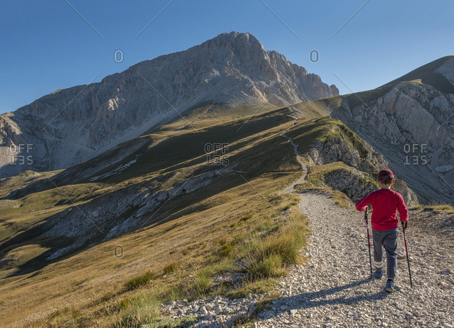 Italy- Abruzzo- Gran Sasso e Monti della Laga National Park- boy on hiking trail of Corno Grande