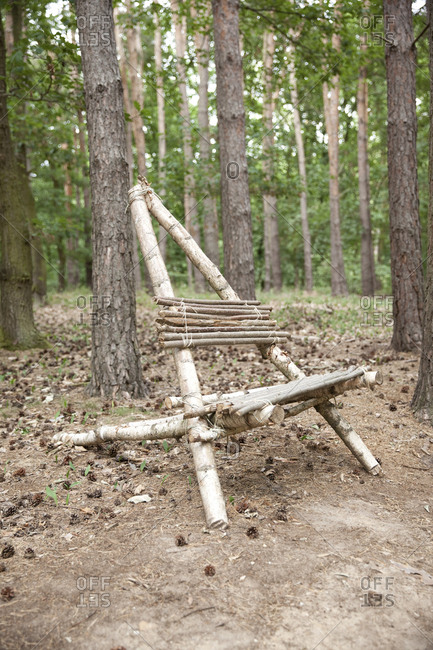 Self-made wooden chair in forest