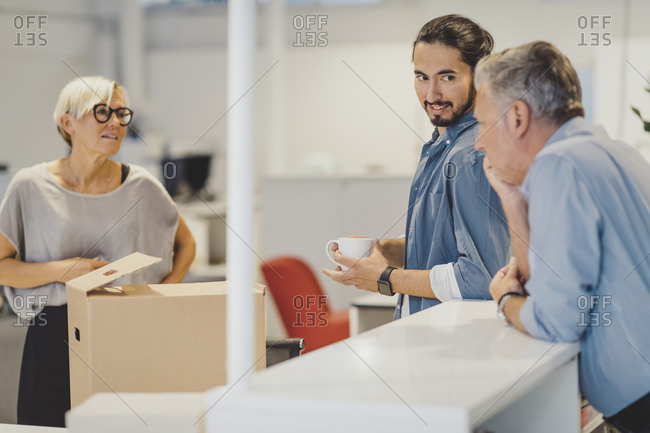 Multi-ethnic business people discussing in new office