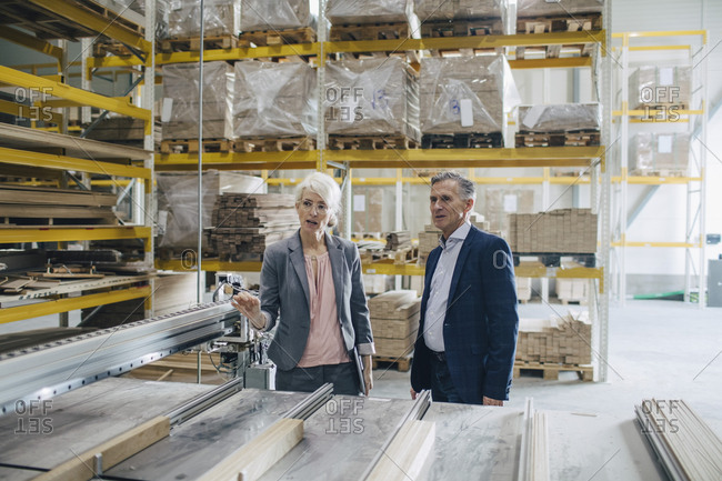 Business people analyzing wooden planks at industry